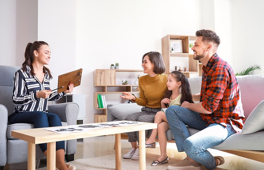 Family discussing home outline with professional