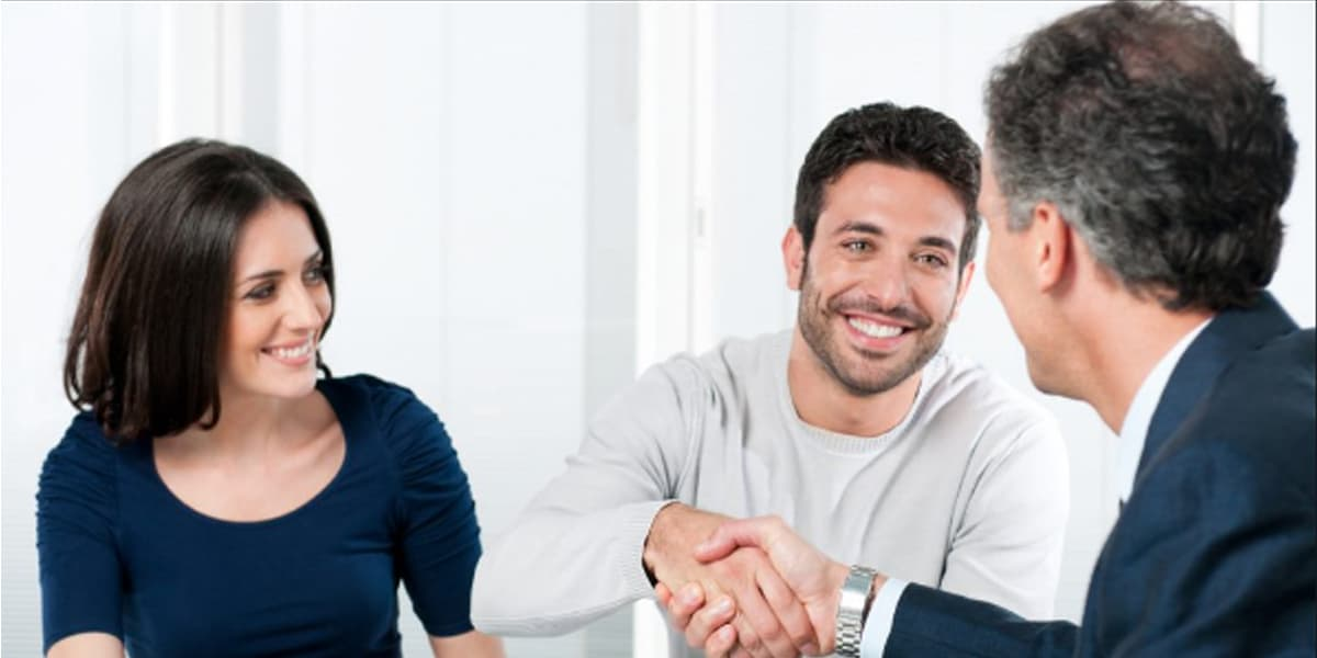 Couple shaking hand for loan approval