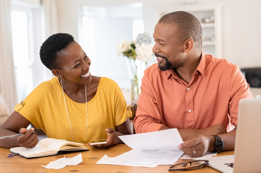 Couple reviewing documents together