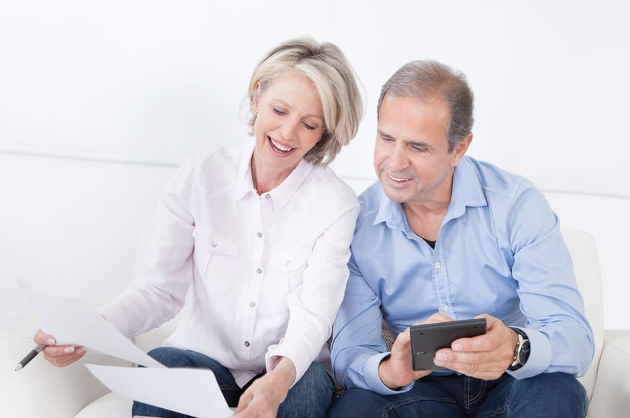 older couple reviewing financials