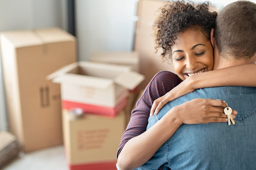 couple embraces each other when they move into new home