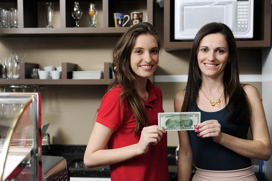 Business owners holding money