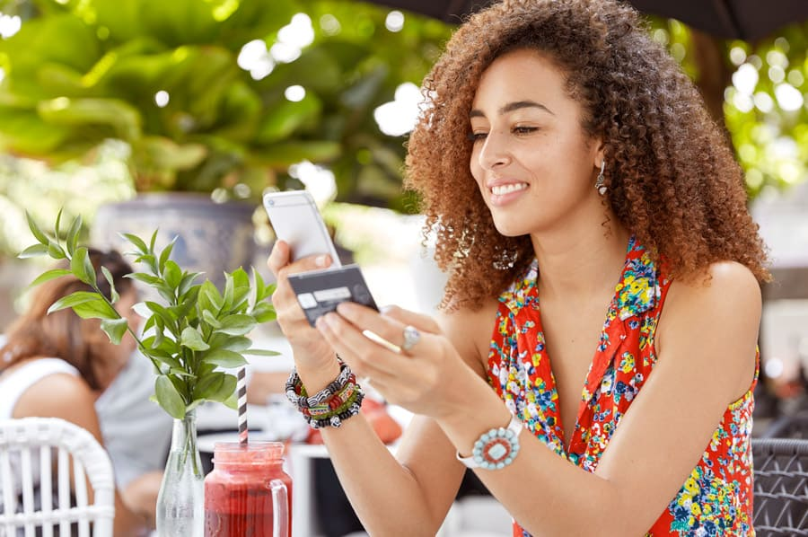 woman buying something on mobile device