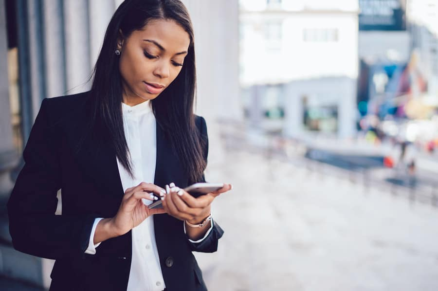woman looking at something on mobile device