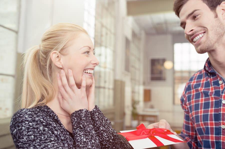Man giving a female a gift card