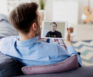 a person holding and using a table for a video call