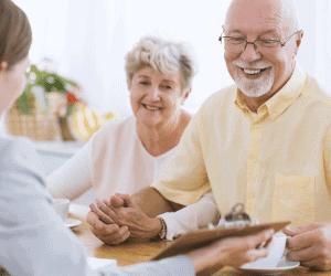 Older Couple Buying insurance