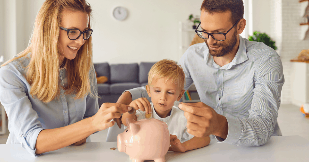 Two parents and a child with a piggy bank