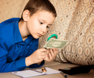 A child holding some money